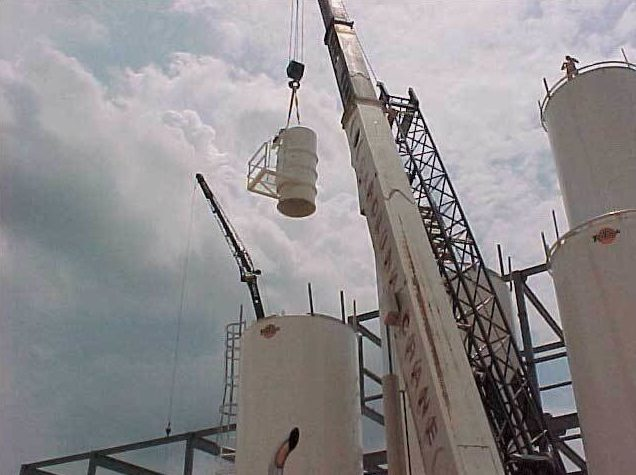 Installing a CAMCORP bin vent on top of a silo