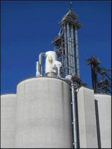 Installed low pressure reverse air dust collector on top of silo