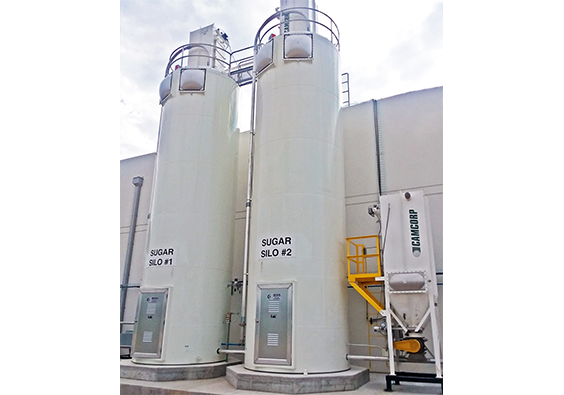 Two sugar bulk storage silos with explosion venting